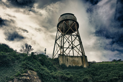 The bulky sihlouette of the watertower on Alcatraz island in San Francisco Bay.
