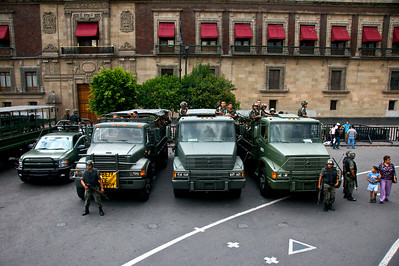 MEXICO CITY - AUGUST 8, 2008: Mexican army soldiers look out on the Zocalo from trucks in Mexico City, Mexico.