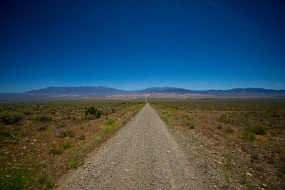 A long gravel road in Nevada stretches into the wilderness.