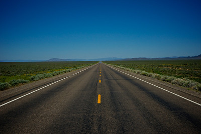 The loneliest road in America stretches into infinite distance of Nevada.