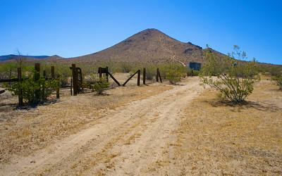Dirt Road Alongside Corral